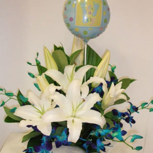 White and blue flowers in box with balloon
