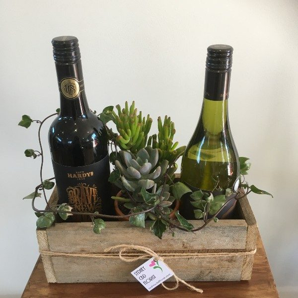 2 wines and plant or flowers